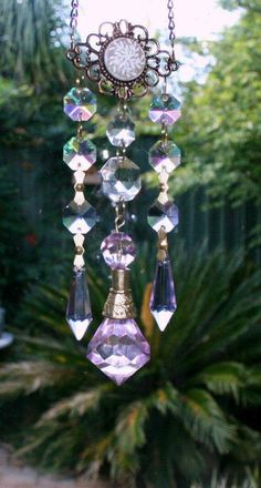 Rainbow Makers and Wind Chimes Crystal Prisms Sun by MindGlowing Crystal Wind Chimes, Glass Wind Chimes, Diy Wind Chimes, Hanging Crystals, Wind Spinners, Glass Garden, Garden Crafts, Wire Art, Mobiles