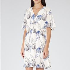 New with Tags REISS dress size 8 REISS dress silk in size 8 brand new with tags.! ! ! MIDI length with flowing sleeves and amazing bounce. original price is 320$ Reiss Dresses Midi