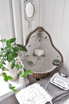 A perfect little sink for a small bath...love the shape of this glamorous little corner sink.