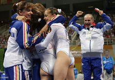 The Romania team celebrate winning the women's artistic gymnastics team final uneven on August 17, 2004 during the Athens 2004 Summer Olympic Games at the Olympic Sports Complex Indoor Hall in Athens, Greece.
