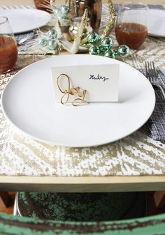 I'm convinced hosting a great dinner party is made up of 80% natural talent and 20% memorable details. There's something special about having a spot at the table reserved just for you, and it's even more exciting when it's shiny! These metallic place card holders are a quick way to add a little more charm to your tablescape without worrying about whether your guests will have anything interesting to talk...