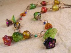 Colorful Flower necklace. Glass Flower and Leaf beads. Victorian style handmade jewelry by TheAmethystDragonfly