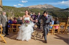 Bride and groom walk out from their ceremony hand in hand with their doggie between them at Lodge at Breckenridge in Colorado. - April O'Hare Photography http://www.apriloharephotography.com