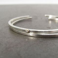 A single sparkler sets this skinny cuff apart. #etsy #etsyjewelry