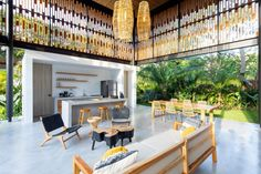 The main living room is mostly open to the elements. Its steel structure forms a double-height space, within which only the kitchen rests against a solid wall. Tropical Architecture, Amazing Architecture, Architecture Design, Houses In Costa Rica, Beachfront Property, Steel Columns, Lobby Interior, Interior Design, Modern Tropical