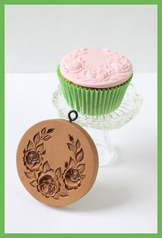 Rose swag cupcake, together with the springerle mold.