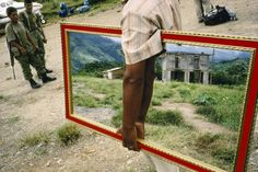 Alex Webb PERU. 1993. Palmapampa. Mirror vendor on a landing strip Magnum Photos Photographer Portfolio