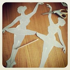 Paper cut out of ballerinas.