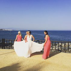 Bride and bridesmaids on the promenade during photographs.