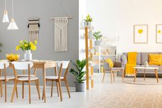 White wooden chairs at dining table in bright open space interior with armchair and couch. White Wooden Chairs, Wooden Tables, Space Interiors, Interior Decorating, Interior Design, Interior Architecture, Living Room Decor, Open Plan, House Design