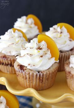 Peach Cobbler Cupcakes - full of cinnamon, peaches and topped with whipped cream icing!