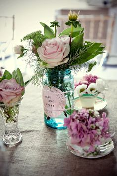 Mason Jars,teacups,vases add variety,maybe a few votive candles too