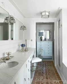 The cabinetry, chest, sconces and ceiling fixtures in this California Arts and Craft cottage are custom-made by designer Madeline Stuart. The counters are Calacatta marble, and the sink fittings are made by THG.   - ELLEDecor.com