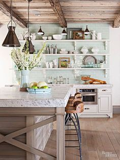 Plank floors and wood ceilings update traditional rustic kitchen designs.