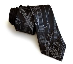 Electric Guitar Necktie. Rock out with your tie out! Weve seen some snooze-worthy guitar ties in our decade of experience as tie-makers...this one is a little more fun. And METAL. We have a festival of electric guitars shown here, from the classic shapes to the flying V.  Shown: Pale grey on peacock, gunmetal, black and eggplant. You can get creative with other colors too, this design looks great in any color combo! Scroll just a little further below for more info on ordering this design on…