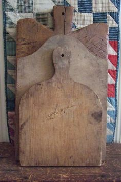 Primitive Wood Cutting Boards against an antique quilt