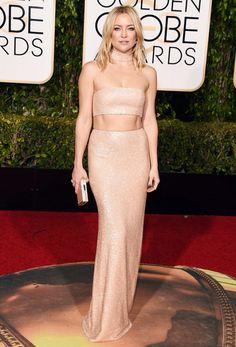 Kate Hudson wears a Michael Kors Collection custom bisque beaded crepe cady bandeau gown.