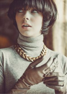 Claudia Dolez in a gold link necklace photographed by Laurent Nivalle