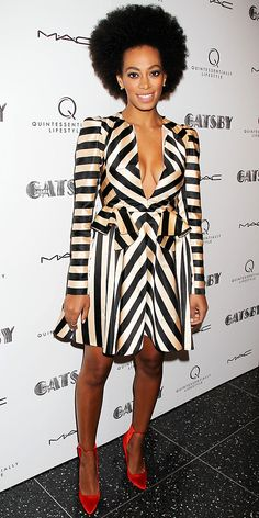 Solange Knowles made a statement in a black and white dress and bright satin heels at MoMa.