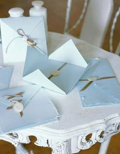 These baby-blue invites are cute as a button—and easy to create!