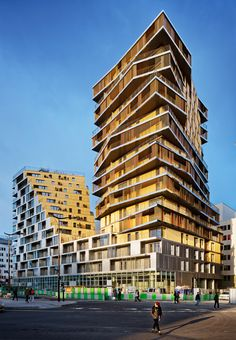 Built by Hamonic + Masson & Associés,Comte Vollenweider in Paris, France with date Images by Takuji Shimmura . Members of the Council of Paris revised the urban regulations for the Masséna- Bruneseau sector in Paris' southeaster. Architecture Résidentielle, Futuristic Architecture, Amazing Architecture, Social Housing Architecture, Building Design, Building A House, Habitat Collectif, Tower In Paris, High Rise Building