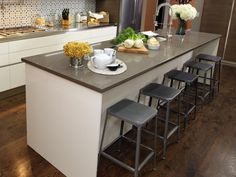 Kitchen island stools provide convenient seating, but be careful not to overcrowd your space.