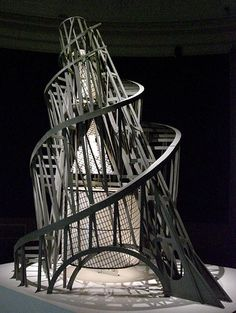 """Tatilin. """"Tatlin's idea was to create a monument to the Bolshevik revolution, by way of a 400m tower consisting of four suspended geometric structures designed to make full revolutions over different periods of time. Unfortunately Tatlin's tower was never realised due to the civil war, and lack of funds""""- the site"""