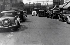 1938: Looking down a side street to the Madison Theatre, on Myrtle Avenue. Great cars!