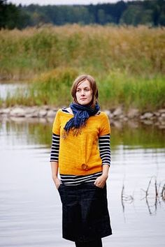 Digging the short-sleeved sweater over the striped top.