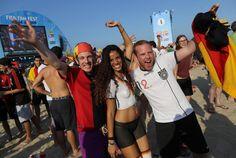 A German fan sports trompe l'oeil body paint in her team's colors.