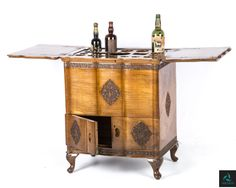 If you are entertaining this Holi, dress up your home! Featuring the antiqued hand carved wooden Liquor/Wine serving Bar Cabinet, with a hinged top and polished cabinets. Call us on 022 2443 4306, single unique unit only.