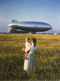 Mother and son look at the blimp, 1955