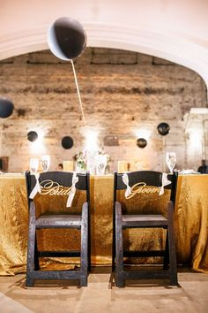 Gold + Black Wedding Decor with balloon table numbers