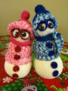 DIY Snowman socks!Use long socks and cut tops off at the ankle.Turn inside out and tie end off with a rubber band.Turn back inside out again so rubber band is hidden on inside.Tie top closed with rubber band (this will be hidden by a hat)Cut ends off a decorative sock and slip the tube over body of white sock to make a sweater.Use rubber bands to define three snowballs.Cut toe off decor sock to use as hat.