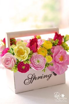Spring carton of pink and yellow flowers