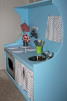 Entertainment center turned play kitchen:)
