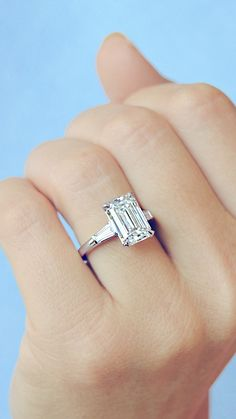 engagement ring verlobungsring Elegance and Style with this classic Artdeco Emerald cut diamond engagement ring with tapered diamond baguettes side stones set on a delicate platinum band, by Ascot Diamonds Emerald Cut Diamond Engagement Ring, Elegant Engagement Rings, Emerald Cut Rings, Engagement Ring Cuts, Antique Engagement Rings, Diamond Wedding Bands, Engagement Rings With Baguettes, Diamond Rings, Solitaire Rings