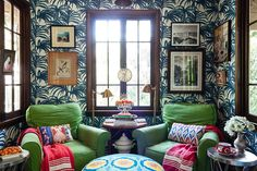 Mixed colors and patterns lend this sitting room an ultra-cozy and collected feel.
