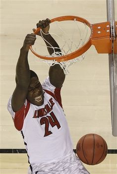 Louisville forward Montrezl Harrell (24) dunks the ball against Michigan during the first half of the NCAA Final Four tournament college basketball championship game Monday, April 8, 2013, in Atlanta. (AP Photo/David J. Phillip)