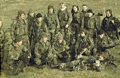 Falklands War: Special Boat Squadron and 148 Commando Forward Observation Battery commandos, after zeroing weapons at San Carlos, May 1982.