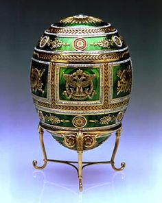 Napoleonic Egg, 1912. This egg is made of yellow gold, covered with green enamel panels, rubies and diamonds. Created to commemorate the centenary of Russia's victory over the armies of Napoleon - and in particular the victory at Borodino in 1812 - double-headed eagles and battle trophies also decorate the egg's surface.