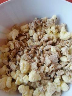 Mom's yummy puffed corn & chexmix cereal Cook Almond bark until melted then pour on top of puffed corn & chex mix stir well