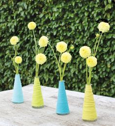 Pretty pop of color for the table...yarn-wrapped-vases-yellow-dahlias