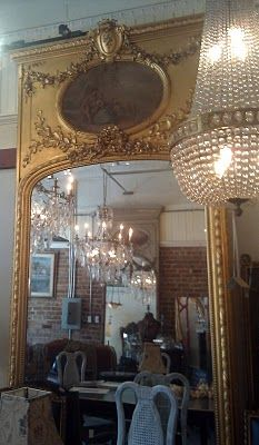 Trumeau:  The mirror is almost always rectangular and sometimes includes a decorative portion at the top, with the mirror below it.    Reproductions of 18th-century trumeau mirrors became popular in the French Regency period.