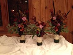 Buffet arrangements keeping with the wine theme, of course! Beautiful fall colored orchids, roses, protea, mums and red seeded eucalyptus Seeded Eucalyptus, Where The Heart Is, Orchids, Buffet, Roses, Wine, Table Decorations, Fall, Beautiful