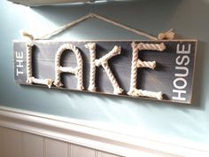 Thanks lesterpamala for this post.The lake house sign - nautical rope sign - lake house decor - nautical sign - la.The lake house sign - nautical rope sign - lake house decor - nautical sign - lake life - lake house gift The Lake House! Beach Cottage Style, Lake Cottage, Coastal Cottage, Beach House Decor, Coastal Decor, Lake House Signs, Lake Signs, Beach Signs, Cabin Signs