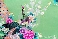 Beautiful silk fabric of light green color with the bright image of a peacock among flowers.g