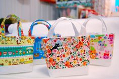 Tiny Kawaii Tote by Happy Zombie, via Flickr.  Do I need a fleet of teeny tiny tote bags?  No, not one little bit.  Do I desperately want to make one in pretty much every fabric I have?  Yep.