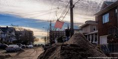 """""""Raising the Flag in Rockaway"""". This simple act after such a devastating circumstance reminded me of the Iwo Jima image and demonstrates the triumph of the human spirit over adversity."""