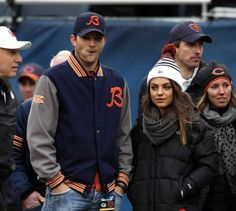 Actors Ashton Kutcher (left) and Mila Kunis (right) watch pre-game warm ups before Chicago Bears-Green Bay Packers game at Soldier Field Dec. 16, 2012.